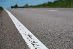Closeup of asphalt road with heighway striping Stock Photography