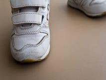 Closeup of children foot walking in sport shoes. Closeup of athlete children walking in sport shoes stock image
