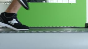 Closeup of athlete`s feet running on treadmill.  stock footage