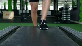 Closeup of athlete`s feet running on treadmill.  stock video