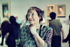 Closeup on attentive senior woman visiting museum and enjoying a Stock Images
