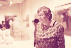 Closeup on attentive senior woman visiting museum Stock Photos
