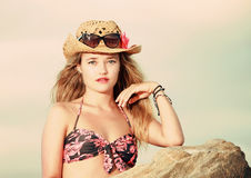 Closeup of attractive blonde with cowboy aht and sunglasses Stock Photos