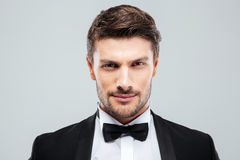 Closeup of attractive confident young man in tuxedo. With bowtie stock images