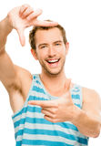 Closeup of attractive happy man framing photograph white backgro Royalty Free Stock Photos