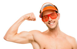 CLoseup of attractive young man flexing bicep muscles on white b Royalty Free Stock Photos