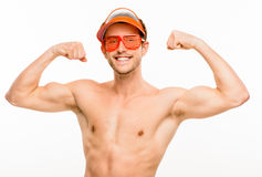 CLoseup of attractive young man flexing bicep muscles on white b Royalty Free Stock Photo