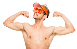 CLoseup of attractive young man flexing bicep muscles on white b Royalty Free Stock Image