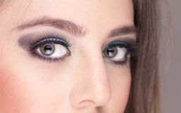 Closeup of attractive young woman wearing makeup Royalty Free Stock Images