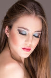 Closeup of attractive young woman wearing makeup Stock Photo