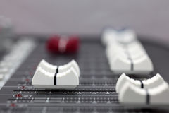 Closeup of audio mixing console. Shallow depth of field Stock Photography