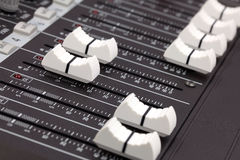 Closeup of audio mixing console. Stock Images