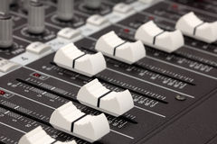 Closeup of audio mixing console. Shallow depth of Royalty Free Stock Photography