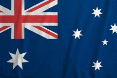 Flag of Australia, with fabric texture. Closeup of Australia national flag background, with fabric texture Vector Illustration