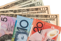 Closeup of Australian Dollar and American US Dollar Royalty Free Stock Photo
