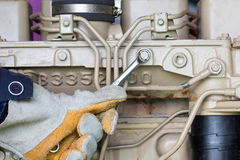Closeup of an auto mechanic working on a Generator power Stock Image