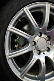 Closeup of automobile wheel. Wheel of the car standing on a show-window Royalty Free Stock Photography