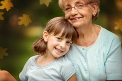 Autumn portrait. Closeup autumn portrait of happy grandmother with granddaughter outdoors Stock Photography