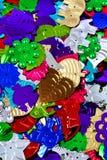 Closeup av blandade sequins Royaltyfri Bild