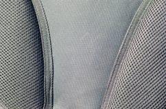closeup av breathable ingreppstyg för textur i den svarta fotoryggsäcken Textur av den svarta plast- vävpåsen Bakgrundsimag Royaltyfri Bild