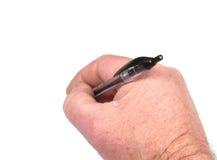 Closeup av den hållande pennan för hand Arkivfoto