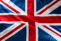 Closeup av den Union Jack flaggan Uk sjunker Brittisk Union Jack flaggablo fotografering för bildbyråer