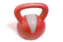 Closeup av en röd 8 kg kettlebell Arkivbild