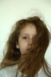 Closeup av flickan med att blåsa för hår Arkivbild