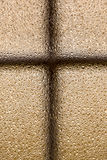 Closeup av frostad brons som fönsterexponeringsglas med en arg form Arkivbild