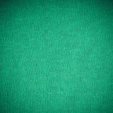 Closeup av grönt tygtextilmaterial som textur eller bakgrund Arkivfoto