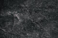 Closeup av mörker texturerad bakgrund Grå grov textur och bakgrund för design Svart abstrakt bakgrund som göras med stenen Arkivbilder