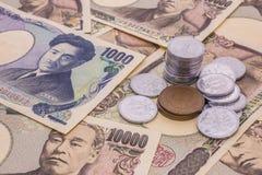 Closeup av sedlar för japansk yen och myntet för japansk yen Royaltyfri Foto