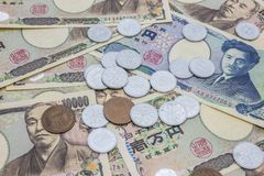 Closeup av sedlar för japansk yen och myntet för japansk yen Arkivfoto