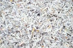 Closeup av strimlade pappers- dokument Arkivbild