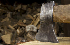 Closeup of an axe sticking in a chunk of firewood Stock Photography