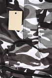 Closeup B&W camouflage pocket pants / shorts with tag Royalty Free Stock Photography