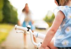 Closeup on baby girl sitting on bicycle Stock Photo