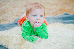 Closeup on baby licking palm Royalty Free Stock Photography