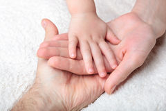 Closeup of baby, mother and father Stock Photos