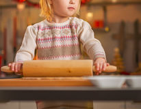 Closeup on baby rolling pin dough in christmas kitchen Royalty Free Stock Photo
