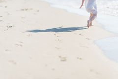 Closeup on baby running on sea shore Stock Photography