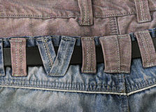 Closeup of the back jean showing and belt.  Stock Photo