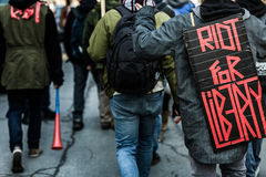 Closeup of the Back of a protester Wearing a Sign Stock Images