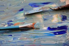 Closeup background of brush and palette Stock Photos