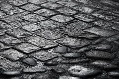 Old wet cobblestone road background texture Stock Photography