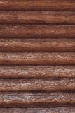 Closeup background from  walls of the wooden blockhouse. Royalty Free Stock Images