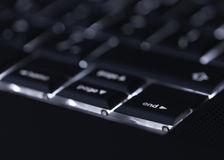 Closeup of backlit computer laptop keyboard selective focus on end key ideal for technology night hacker standout Royalty Free Stock Photo