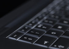 Closeup of backlit computer laptop keyboard selective focus on escape key ideal for technology night hacker standout Stock Photos