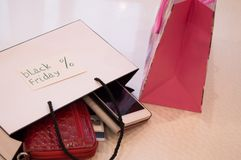 Closeup of bag with a purchase card, wallet, phone. Concept sales, black friday Royalty Free Stock Photography