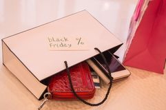 Closeup of bag with a purchase card, wallet, phone. Concept sales, black Friday Stock Photos